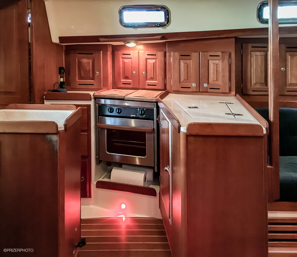 Sail in United States - Cherry wood cabinets.