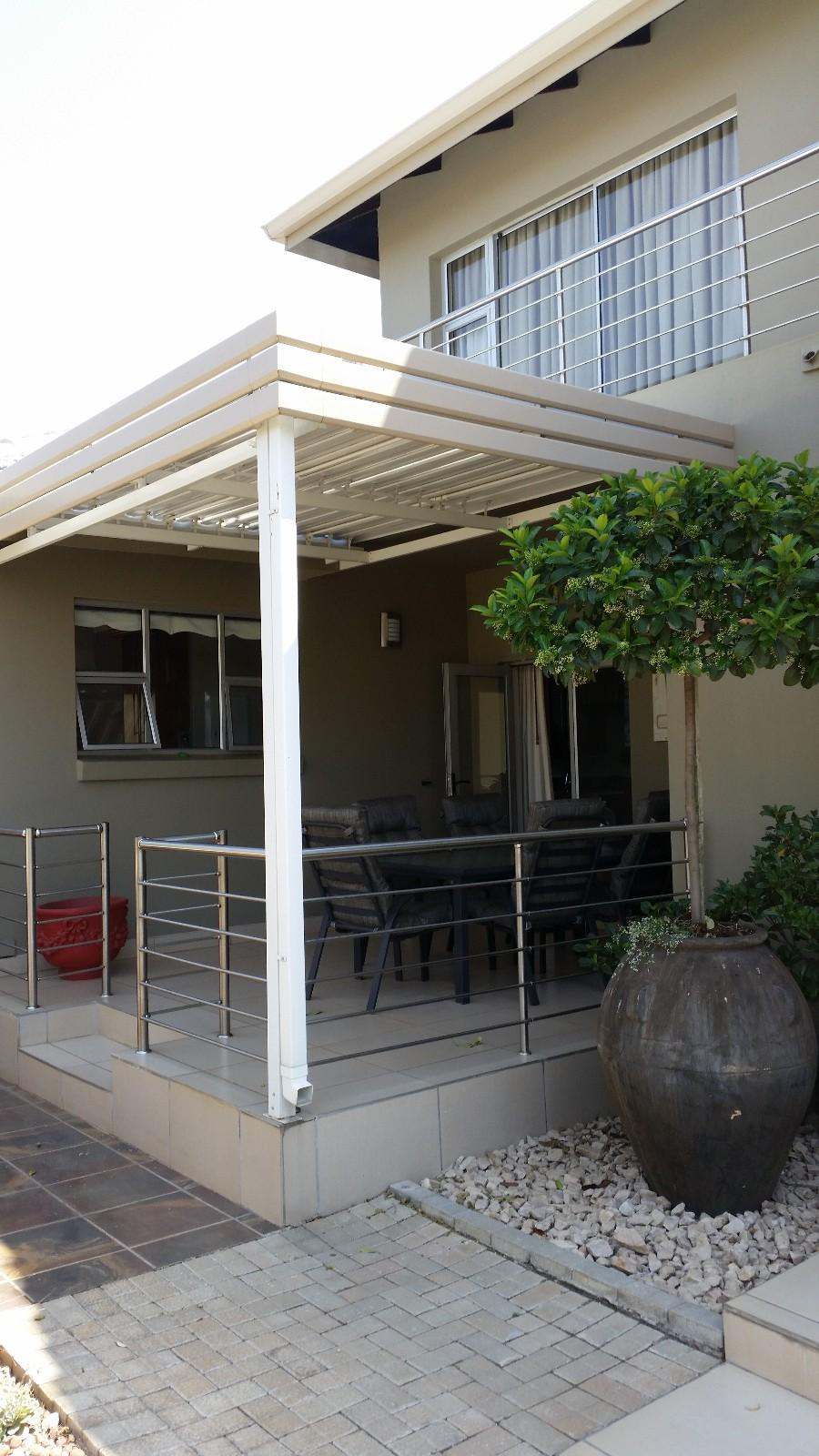 House in Magalies River Club and Golf Estate - Covered_patio_street_level.jpg