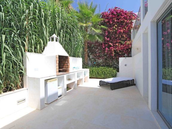 House in Cala Carbó - Lateral terrace with BBQ