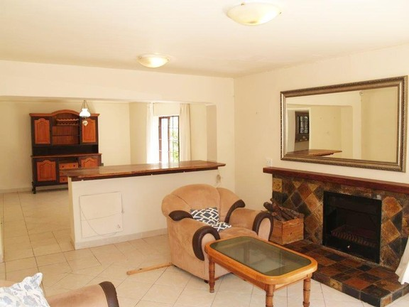 House in Village - Spacious lounge with fire place