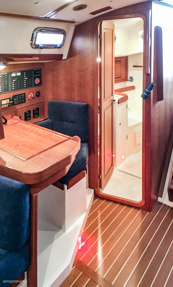 Sail in United States - Enclosed head and shower is aft of Nav station.