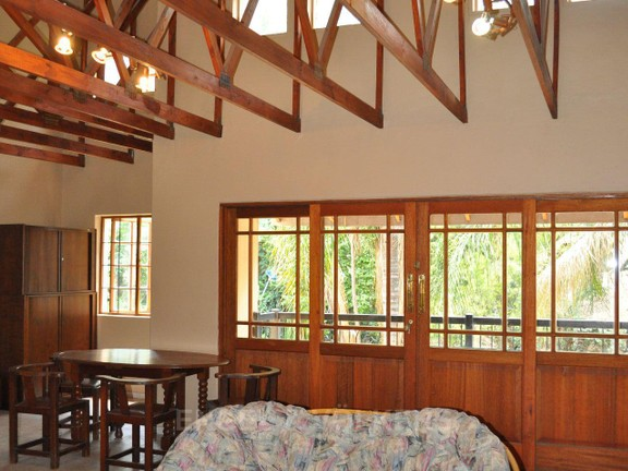 House in Doringkloof - Upstairs lounge with high wooden beam ceiling.JPG
