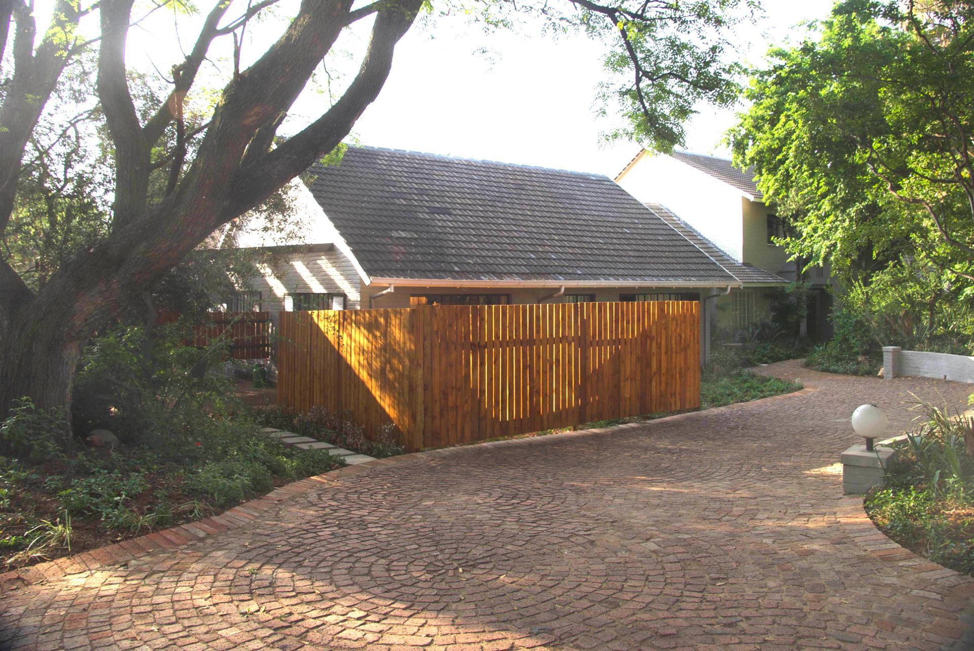 House in Chartwell - West Courtyard Fence Ext.jpg