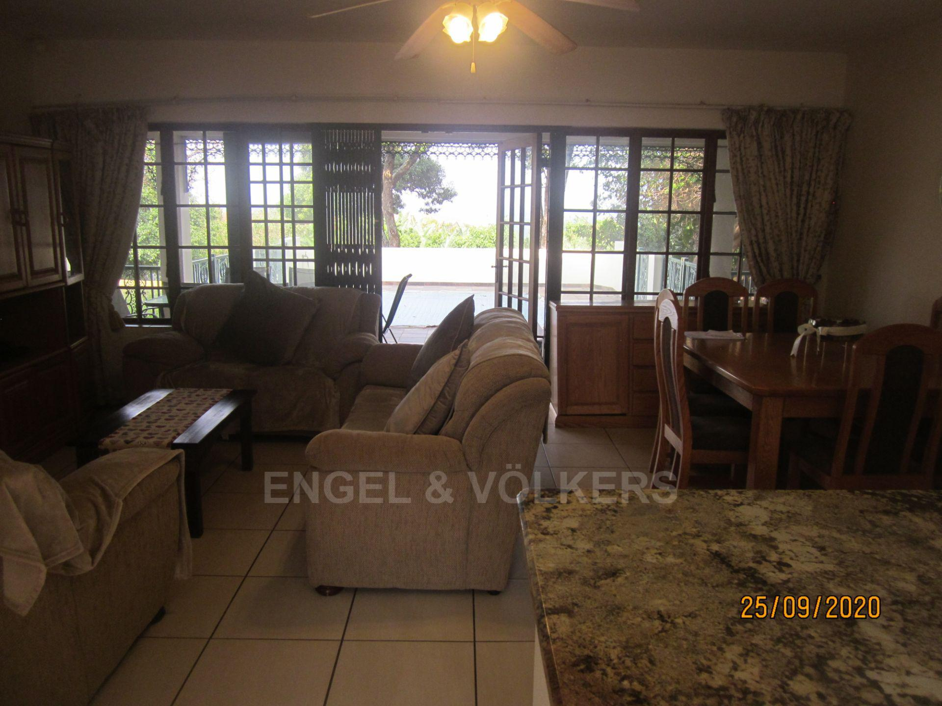 Apartment in Shelly Beach - Lounge/Dining, pool in background
