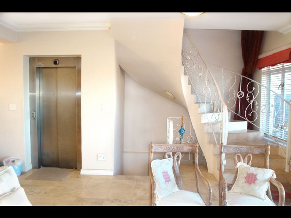 House in Harbour Island - @2 12 Lounge staircase & lift.jpg