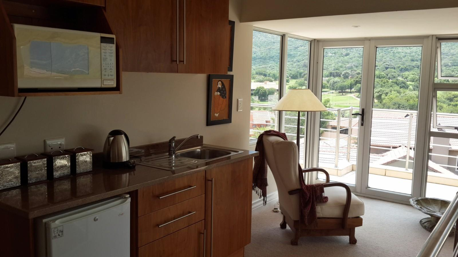 House in Magalies River Club and Golf Estate - Second floor kitchenette lounge.