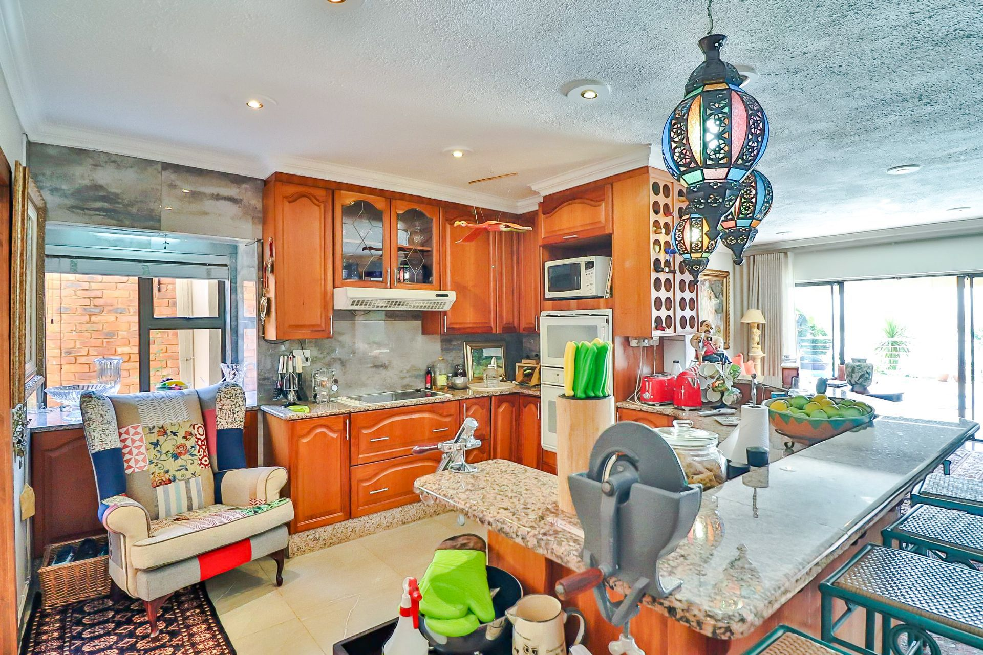House in Kosmos Village - Kitchen is spacious with bar counter, and separate pantry and scullery area