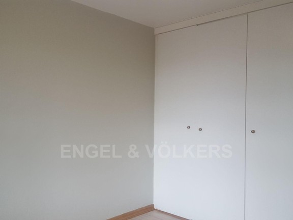 House in Mount Kos - Wardrobes in bedroom.jpg