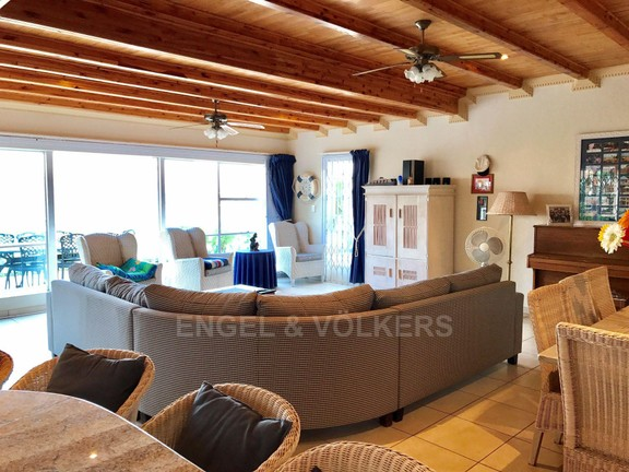 House in Kosmos Village - Lounge leads out to patio.jpg