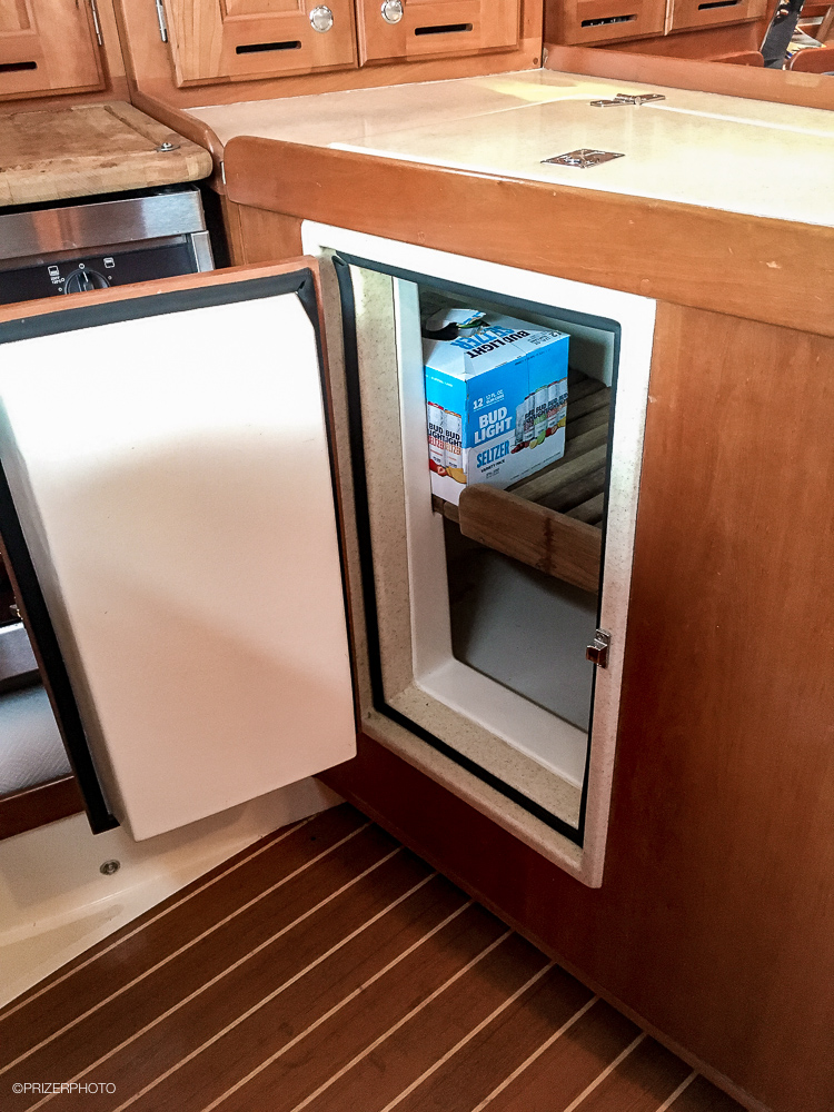 Sail in United States - Refrigerator is top and front loading.