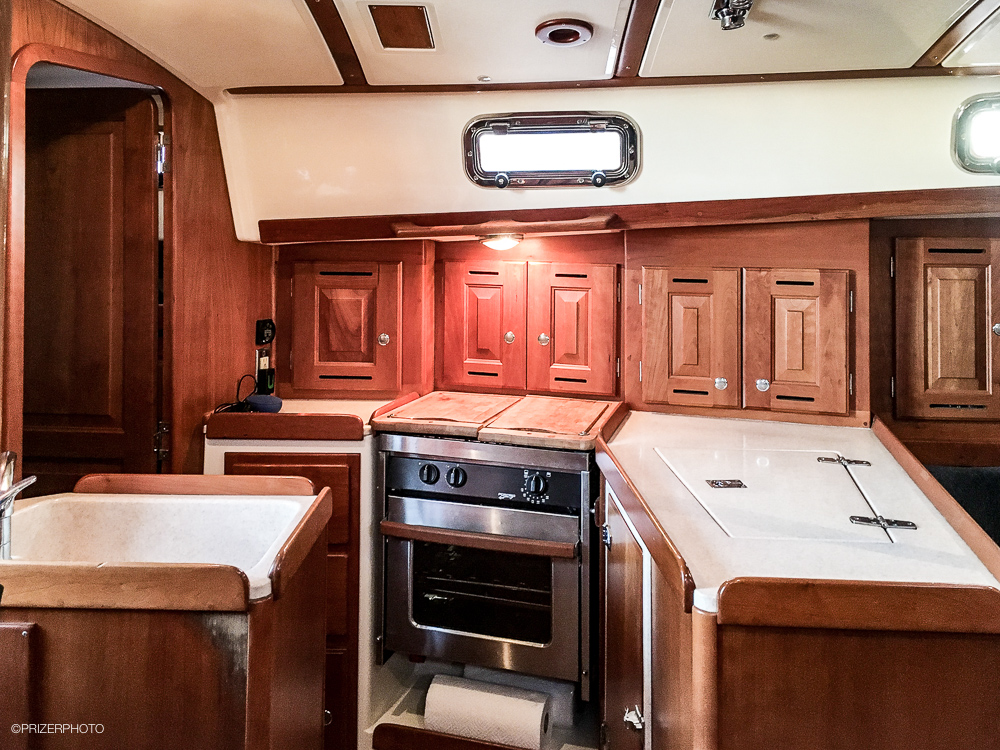 Sail in United States - Galley has a gimballed propane stove and oven