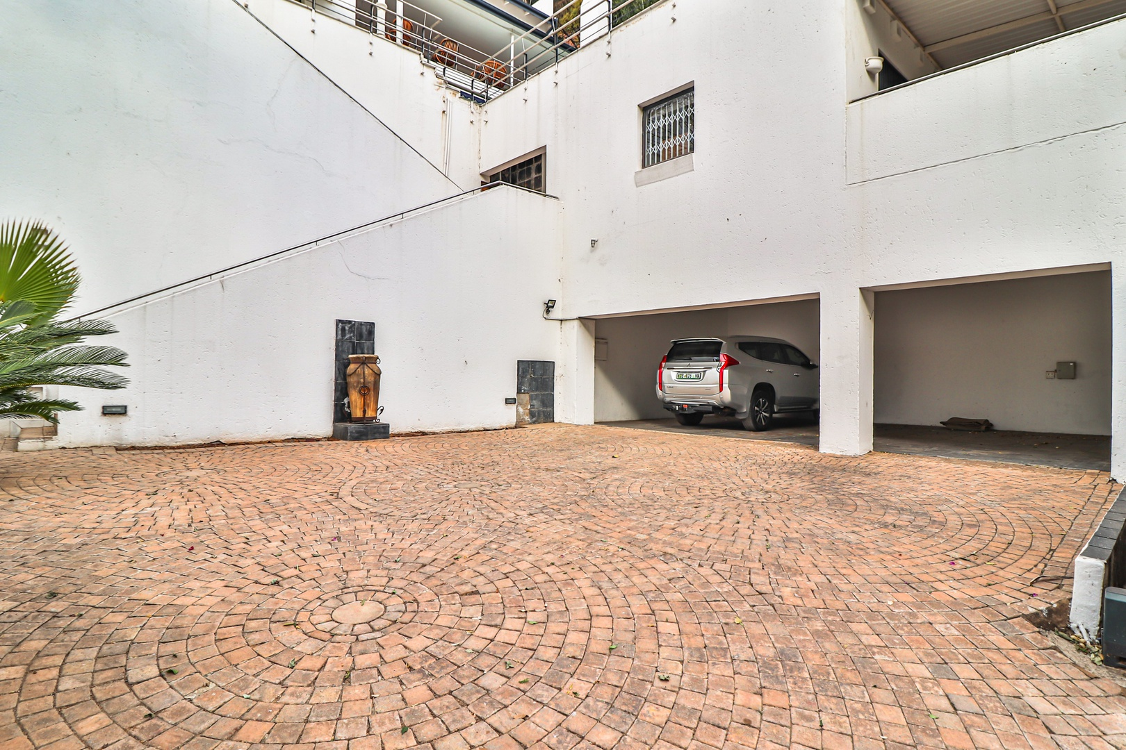 House in Kosmos Village - Garage parking for four to five vehicles plus additional parking space.