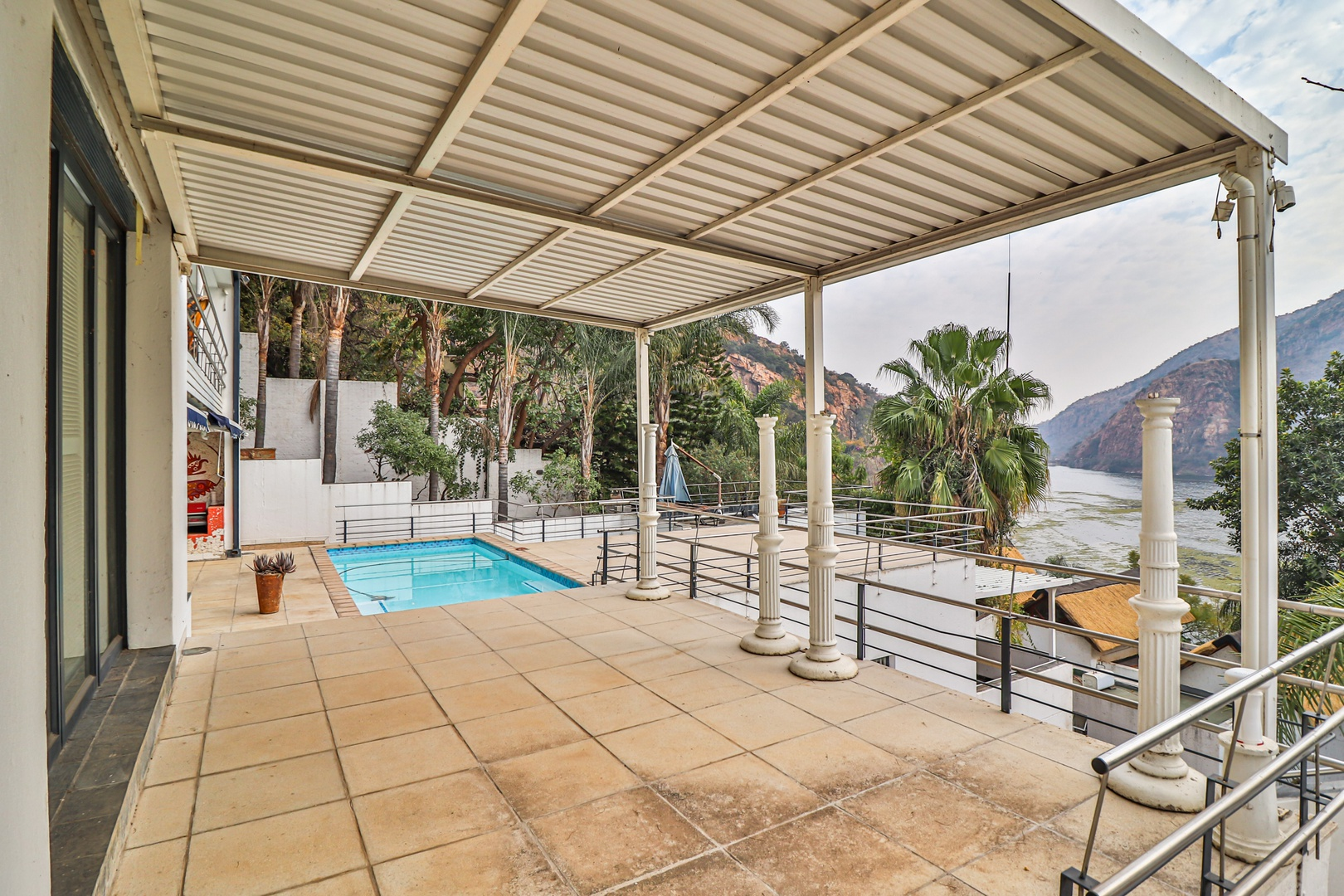 House in Kosmos Village - Pool deck is spacious with plenty of entertaining space