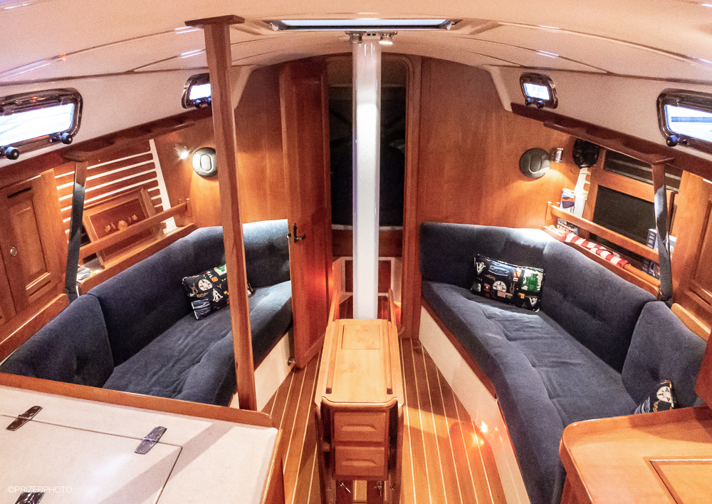 Sail in United States - Solid wood is used extensively for trim, cabinet and door faces. Overhead hatches and the opening portlight frames are polished stainless steel, while the door and cabinet hardware is top quality