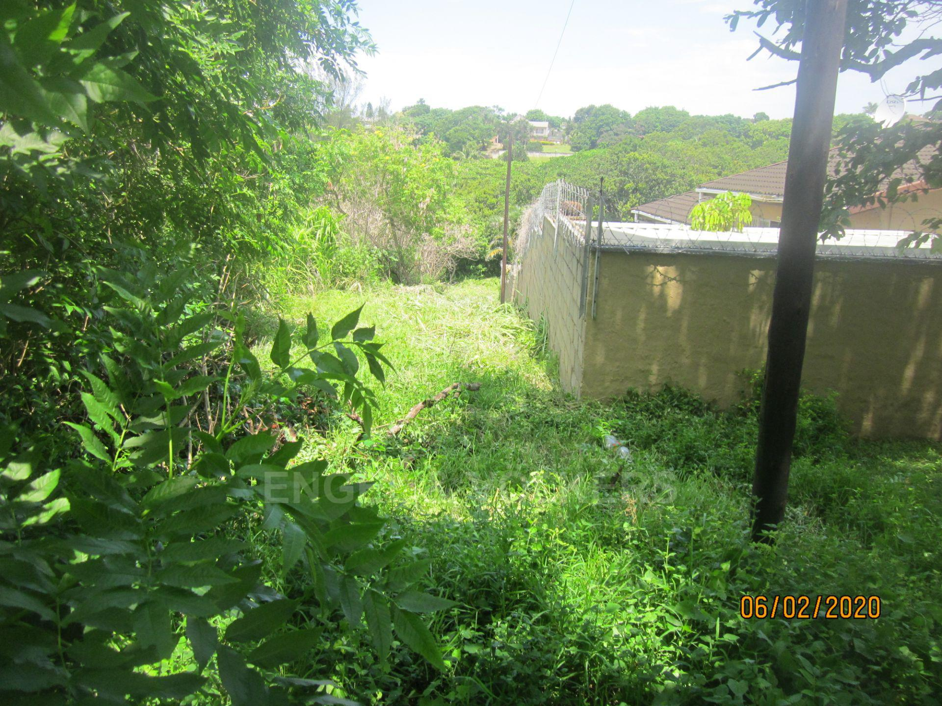 Land in Uvongo - 025 Second plot and adjacent complex wall.JPG