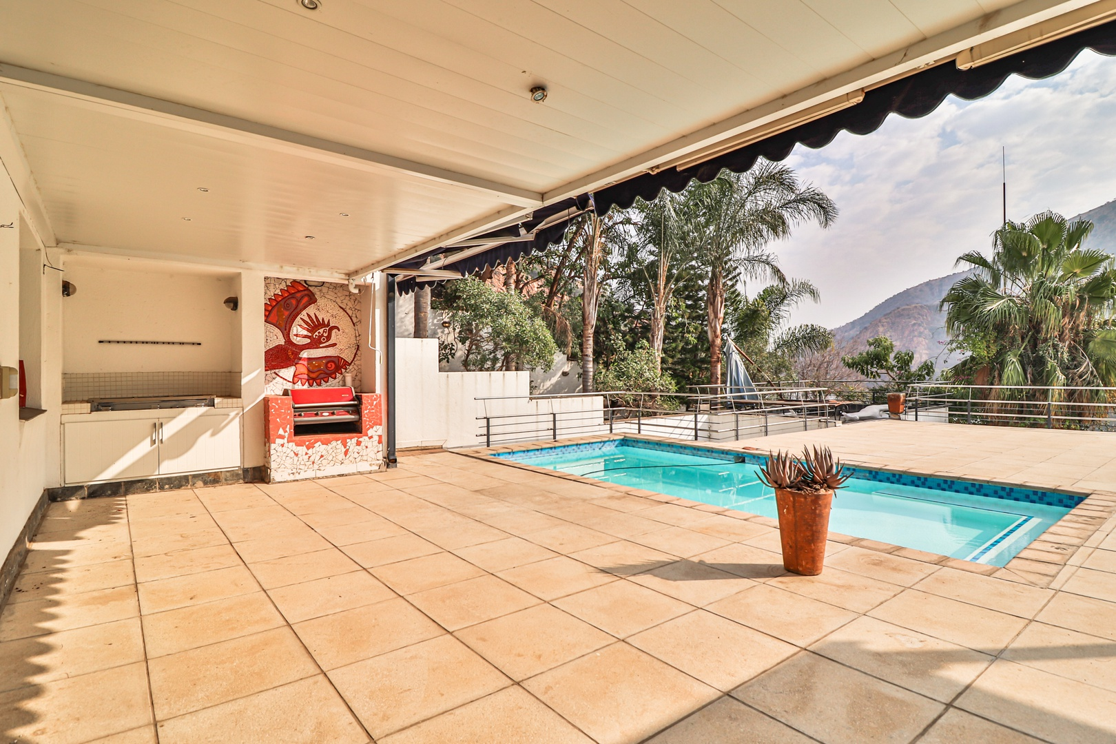 House in Kosmos Village - Living area opens on to pool deck with amazing views!