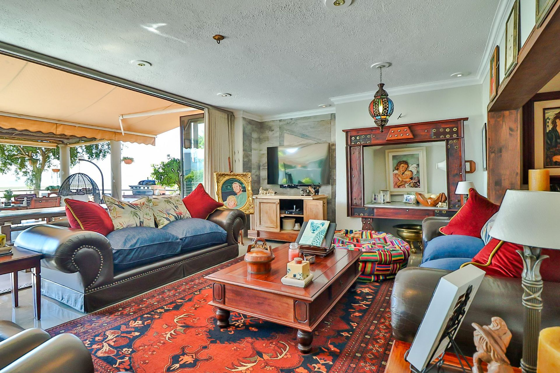 House in Kosmos Village - A glimpse of how the lounge leads seamlessly on to the patio