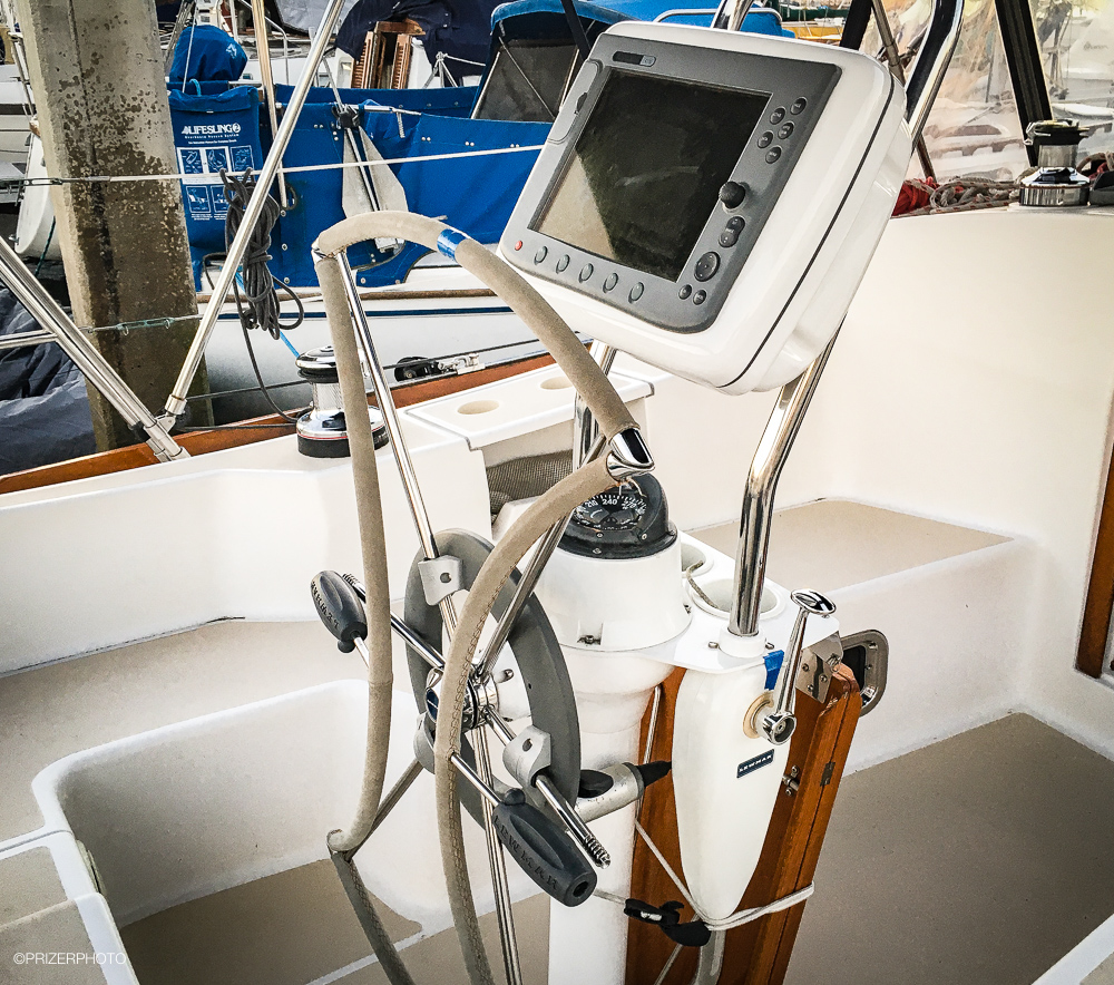 Sail in United States - Folding wheel creates more cockpit space. Binnacle features compass, Raymarine chart plotter, fold up cockpit table, single lever Volvo shifter.