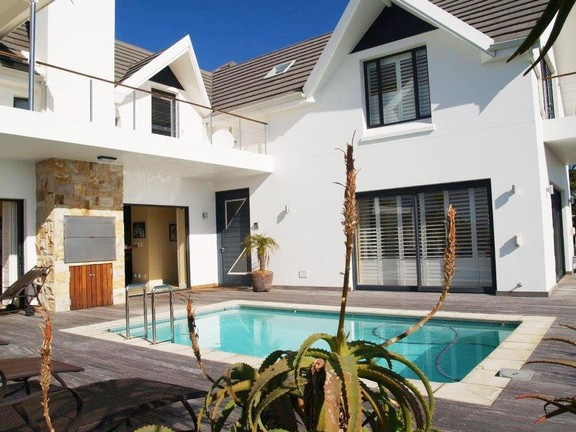 Apartment in Village - Deck With Built In Braai And Swimming Pool