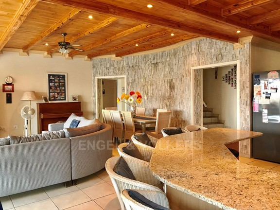 House in Kosmos Village - Kitchen dining and lounge area.jpg
