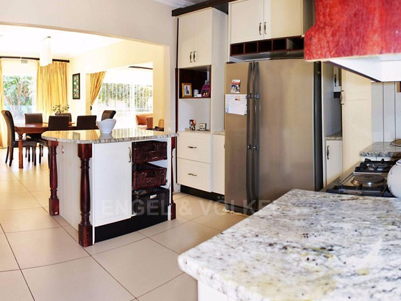 House in Waterkloof Ridge Ext - Kitchen with dining room in background