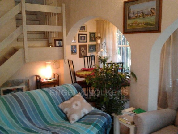House in Vorna Valley - Cottage 2 Lounge with stairs to bedroom.