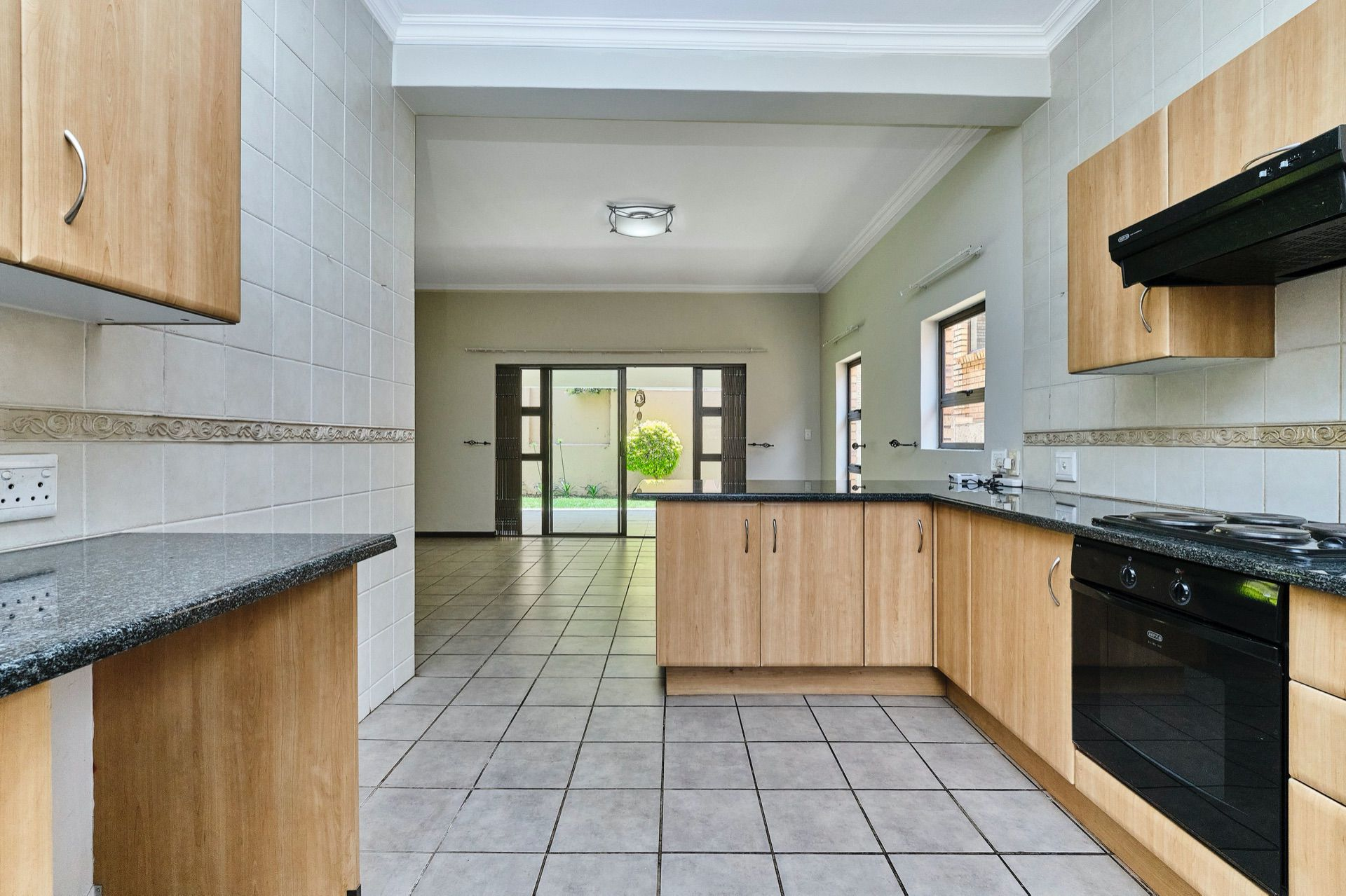 House in Noordhang - Woodlands -Kitchen into dining area.jpg