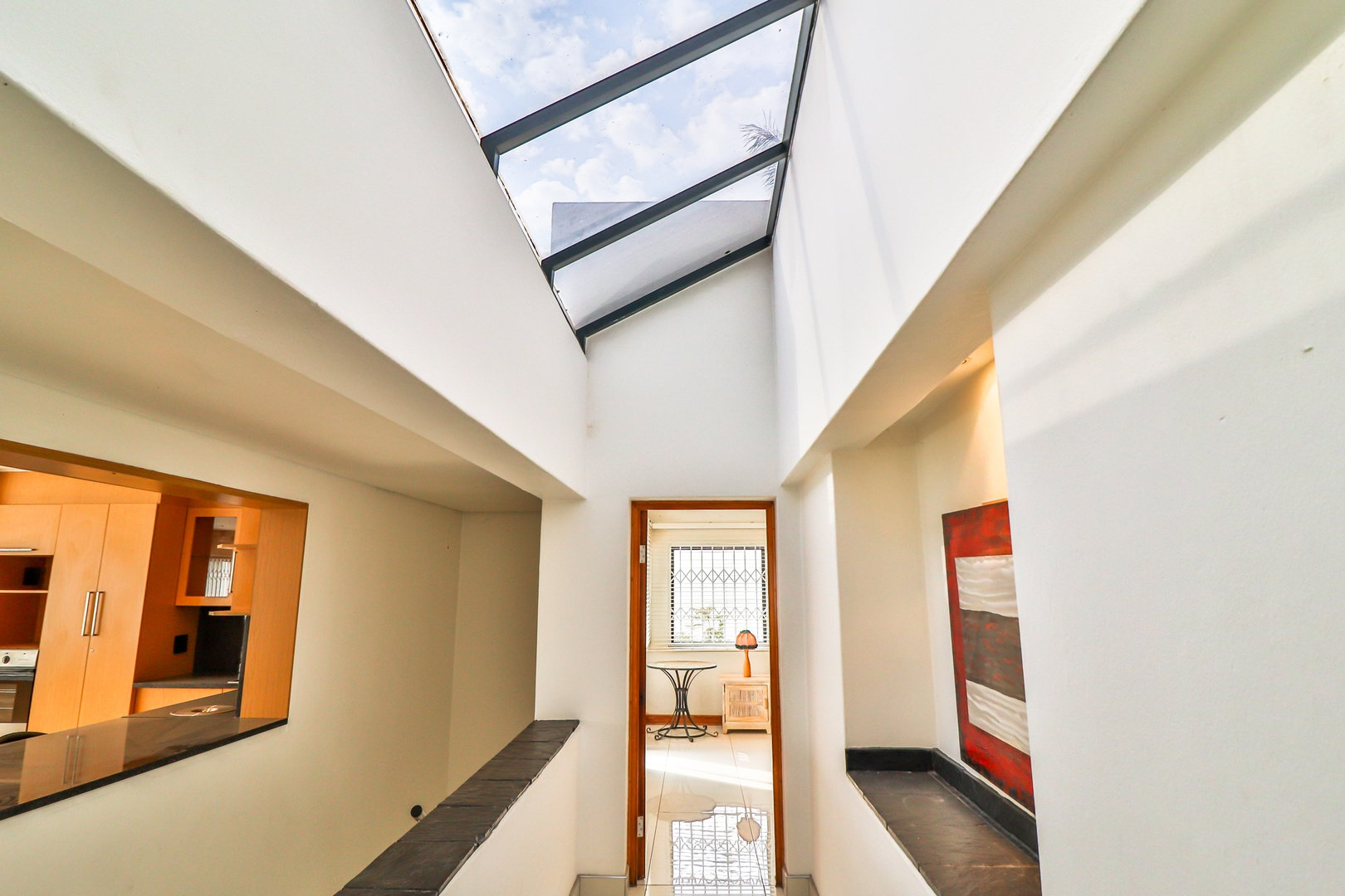 House in Kosmos Village - Passage from bedroom area is light and airy