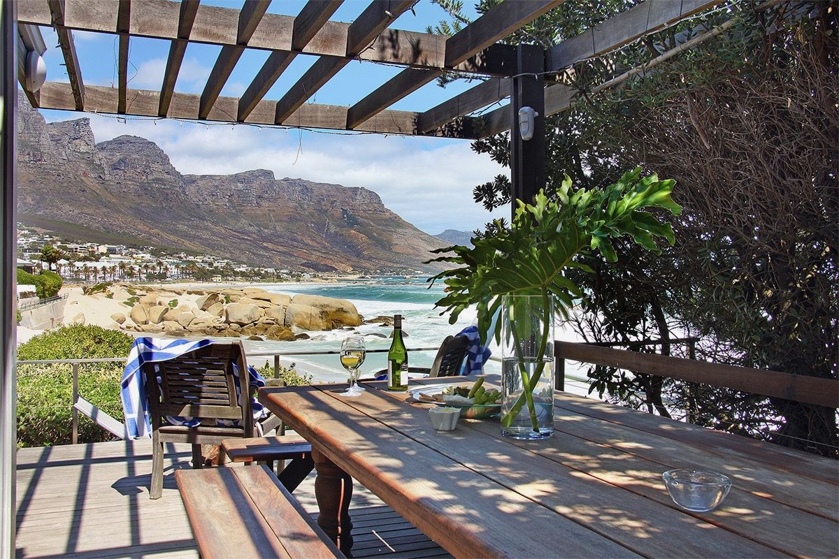 House in Camps Bay - 30.US VIEW OVER PERGOLA TABLE TO BEACH.jpg