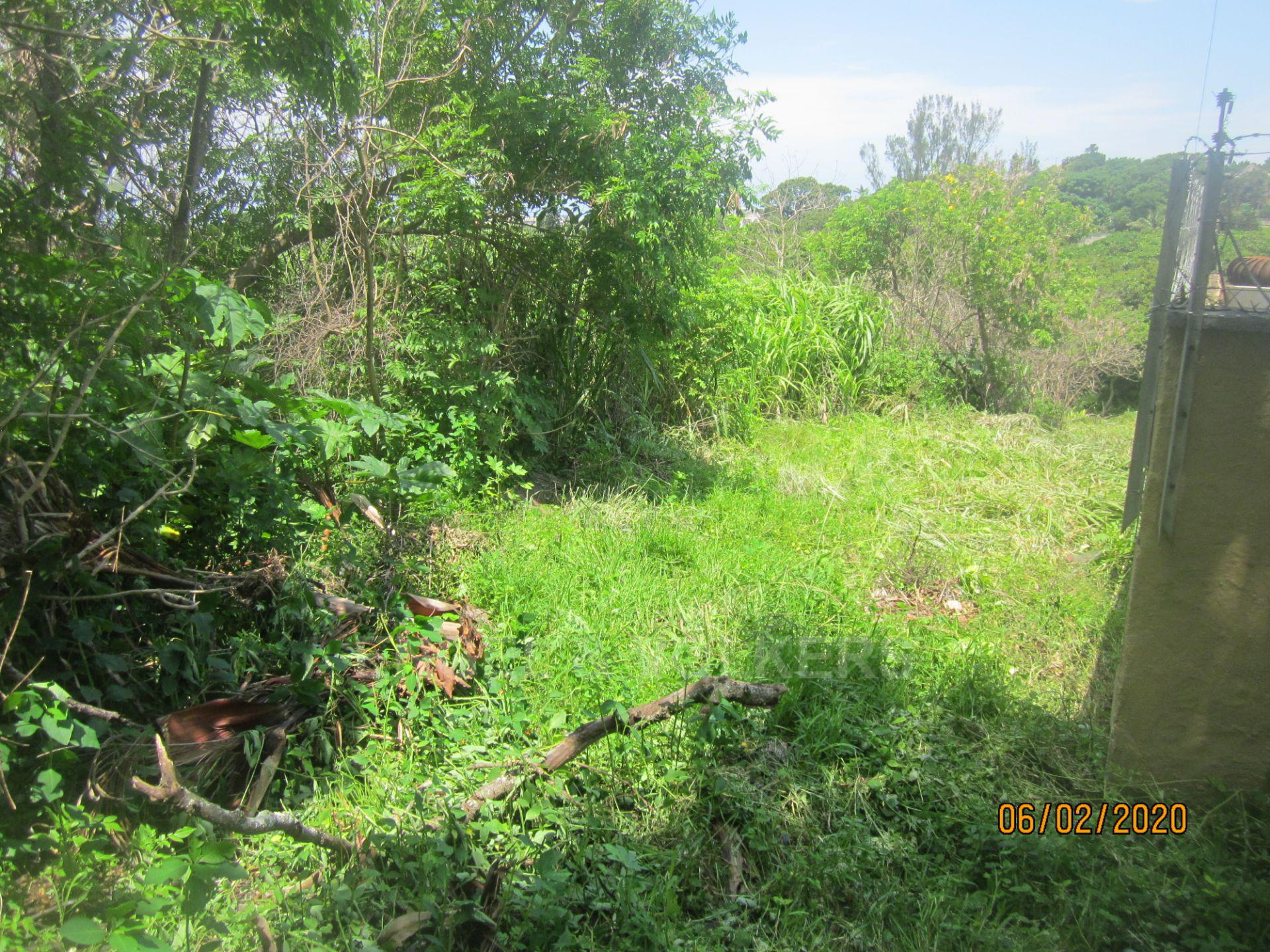 Land in Uvongo - 024 Second plot and adjacent complex wall.JPG