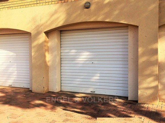 Condominium in Die Hoewes - Double garage, with entrance to building.JPG