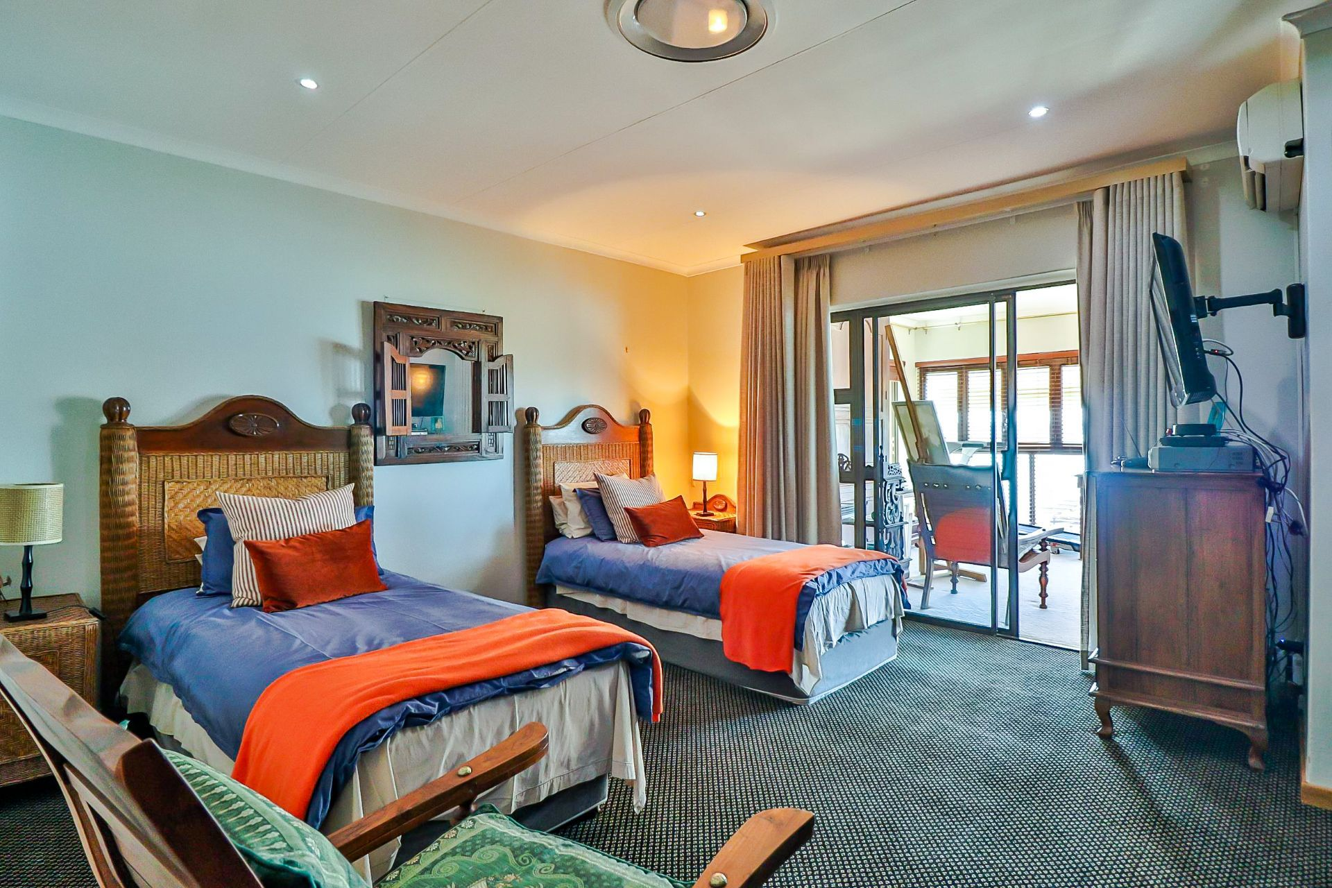 House in Kosmos Village - This bedroom is spacious, wheelchair friendly and has an enclosed patio which leads on to an open balcony
