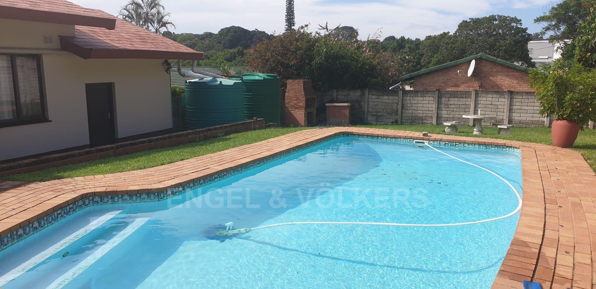 House in Uvongo - 019 - Pool area.jpg