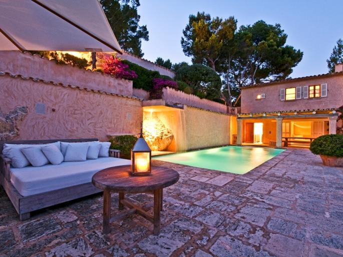 Villa in Camp de Mar featuring a romantic terrace with indirect lighting and a lawn for sunbathing and relaxing