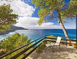 Sun terrace of a villa in Deià with a deck chair and ocean view