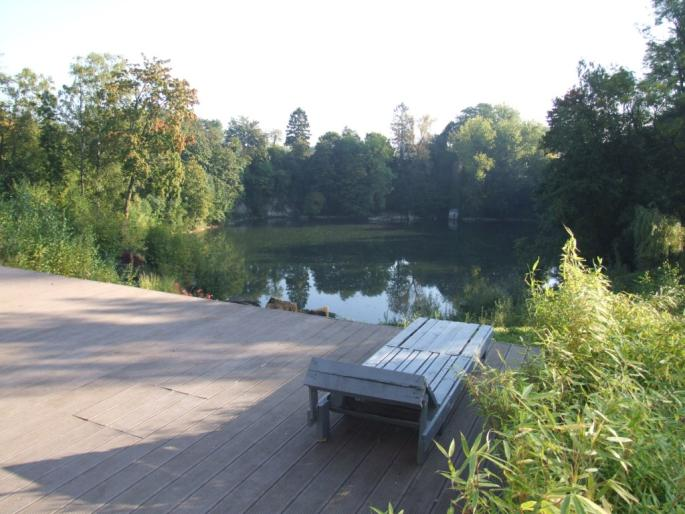 Property in Nivellis with terrace, deck chair, and a lake in the middle of nature