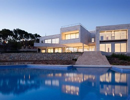 View on the pool and the garden of a designer villa with an exterior staircase to the sun terrace in Santa Ponsa