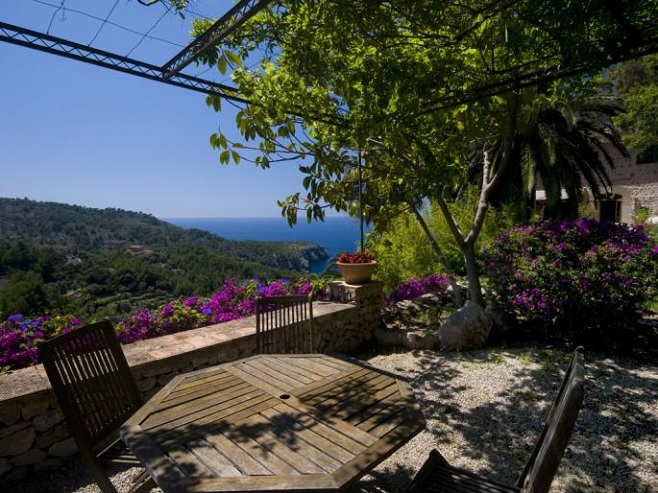 View at the terrace of a villa in Deià with a romantic ambiance and a fantastic view of the sea