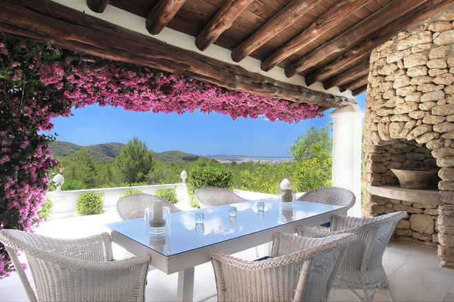 Terrace of a villa in San Juan with a unique view surrounded by pink flowers