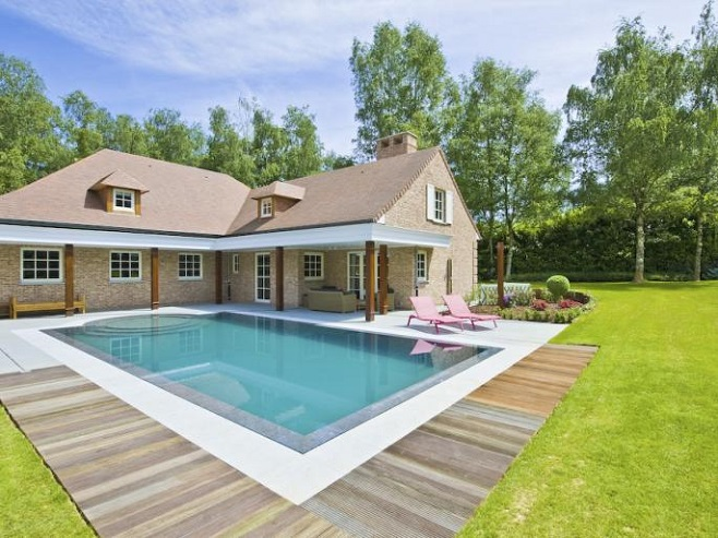 Front View of a spacious villa in Nivelles overlooking the outdoor pool and landscaped garden