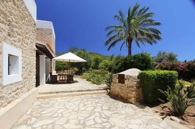 Cozy terrace of a Finca in Santa Eulalia surrounded by Palm Trees