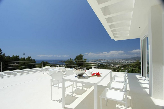 Modern sun terrace of a villa on Ibiza Island with a fabulous view across the island