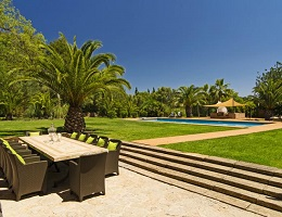 View from a finca in Santa Maria over the spacious property with pool and palm trees