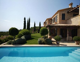View of a natural stone villa in Camp de Mar with large pool and lovely garden