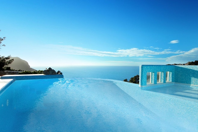 View of an infinity-edge pool of a villa on Ibiza directly over the sea