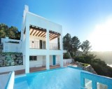 View of a villa in San José with infinity pool, in first sea line.