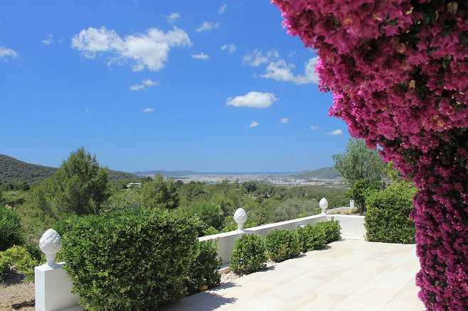 Terrace of a villa in Santa Eulalia, surrounded by flowers