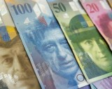 Varoius Swiss Franc notes lay on a table in this picture illustration at a bank in Warsaw