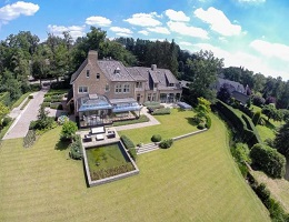 View of a luxury property in Antwerpen with a landscaped garden