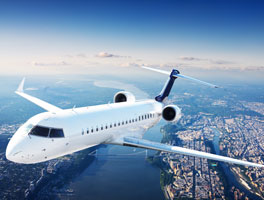 Private-jet-above-city